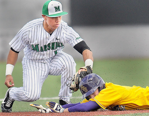 Marshall second baseman Anndrew Dundon. left, tags out East Carolina's Bryan Bass, right, on an attempted steal of second during Sundays game at Linda K. Epling Stadium. F. Brian Ferguson/The Register Herald