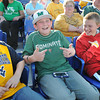Garrett Brooks, 11, son of David and Trisha Brooks, of Crab Orchard, left, Grant Davis, 11, son of Chris and Jennifer Davis of Daniels and Grey Hazuka, 11, son of Greg and Rhonda Hazuka, of Daniels, watch WVU and Marshall play at Linda K. Epling stadium Tuesday night.<br /> Rick Barbero/The Register-Herald