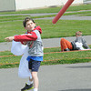 Addison Spurlock trows the noodle javelin during the Cub Scouts Seneca District Olympics held at the State Fair ground in Fairlea.<br /> Rick Barbero/The Register-Herald