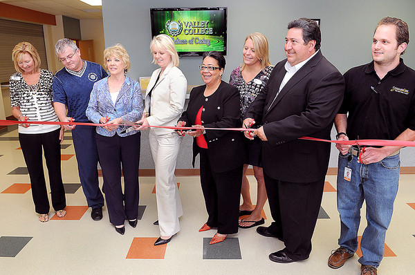 The Ribbon Cutting for the opening of the new location of Valley College in the New River Town Center was held on Monday afternoon. (From left), Margaret O'Neal, Mick Bates, Linda Sumner, Valley College Executive Director, Beth Gardner, Wenetta Rhodes, Beth Keatley, Gil DeLaRosa, and Chase Cappellari. F. Brian Ferguson/The Register-Herald