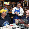 Jim Brown, superintendent of Raleigh County School, center, takes orders from Louie and Tammy Prete, of Fayetteville, order at Calacino's during Celebrity Night. <br /> Rick Barbero/The Register-Herald