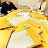 Gayle Bowling, left, and Louann Grose, both with Theatre West Virginia look over the thousands of letters sent to theit office. F. Brian Ferguson/The Register-Herald