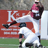 Josh Wenger, of Concord Unversity, tags out Eric Craft, of  West Virginia State University at second base during the championship game of the WV conference baseball tournament Saturday afternoon. Concord won 11-4<br /> Rick Barbero/The Register-Herald