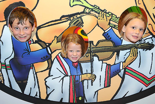 From left, Isiac, Katie and Gracie McAllister, children of Samuel and April McAllister, of Daniels, pose in the photo booth at El Mariachi Mexican Restaurant in Beaver, during Celebrity Night. <br /> Rick Barbero/The Register-Herald