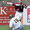 Jerrod Groves, of Concord Unversity, tries to turn over a double play after forcing out, Tyler Payne, of  West Virginia State University at second base during the championship game of the WV conference baseball tournament Saturday afternoon. Concord won 11-4<br /> Rick Barbero/The Register-Herald