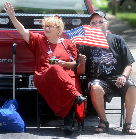 Gail McKinney, left, and Al Chelly, right, came out in large numbers to welcome Rolling Thunder during the 25th year during Thursday's Run for the Wall Event. F. Brian Ferguson/The Register-Herald