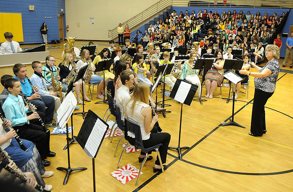 Mary Withers, band director, directs her band at Shady Spring Middle school. Band was the recipient of $30,000 worth of instruments two years ago from VH-1's Save the Music. <br /> Rick Barbero/The Register-Herald