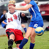 Oak Hill United's Jackie Honaker, left, and WV Rapids Lauren Solock, right, battle for the ball during Saturday's Little General Darrell Moore Memorial Soccer Tournament at the YMCA Paul Cline Memorial Youth Soccer Complex. F. Brian Ferguson/The Register Herald