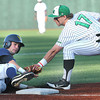 Keven Cohen, left, of WVU, gets tag out by Aaron Bossi, of Marshall during the game at Linda K. Epling stadium in Beckley Tuesday night.<br /> Rick Barbero/The Register-Herald
