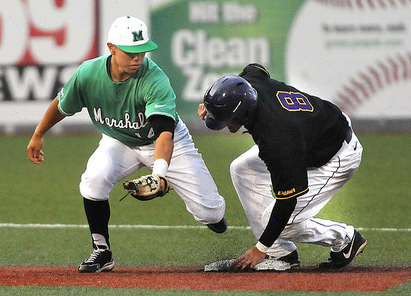 Andrew Dundon, 14, of Marshall, tries to tag out Jack Reinheimer, 8, of East Carolina trying to steal second base. Reinheimer was safe.<br /> Rick Barbero/The Register-Herald