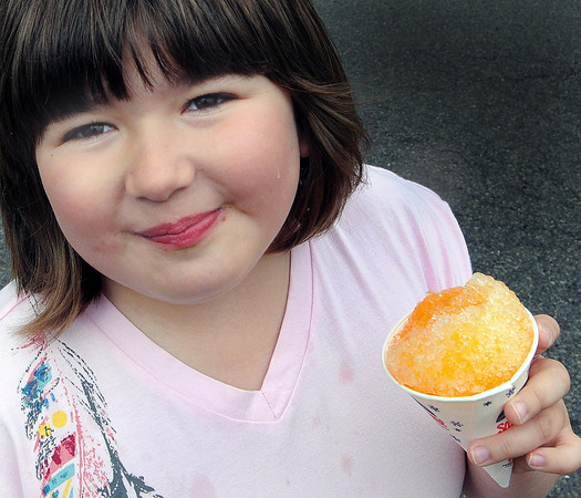 Kaydn Ball, 9, of Beckley, ejoys a snow cone during Saturday's Sweet Sweet Treats Dessert Festival at Word Park. F. Brian Ferguson/The Register Herald