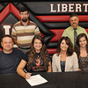Hayley Pioch, of Liberty High School, second from left, signs to play volleyball with West Virginia Wesleyan. Pictured from left, Bill Pioch, father, Hayley, Shannon Hayley, mother, Hannah, sister, back row from left, Archie Johnson, athletic director and Rocky Camgemi, principal.<br /> Rick Barbero/The Register-Herald