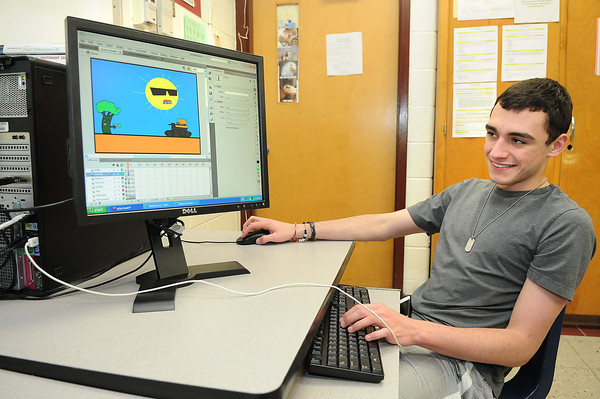 Shane Vess works on his own computer game he designed in Sherri Morgan's Game Design 1 class at Woodrow Wilson High School. He named his game Operation Action Health.<br /> Rick Barbero/The Register-Herald