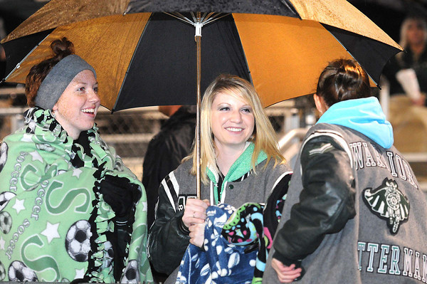 Holly Pettus, left, Emily Poindexter and Carie Gillespie, seniors at Wyoming East watch game against Nicholas Co. at Wyoming East High School.<br /> Rick Barbero/The Register-Herald