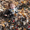 Vincent Colo, 3, son of Dustin & Kimberly Colo, of Beckley, plays in leaves in his front yard on Vine Street.<br /> Rick Barbero/The Register-Herald