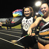 Jessica Spearing, left, and Jessica McPeake, twirl during game against the Oak Hill Red Devils at Oak Hill High School Friday Night.<br /> Rick Barbero/The Register-Herald