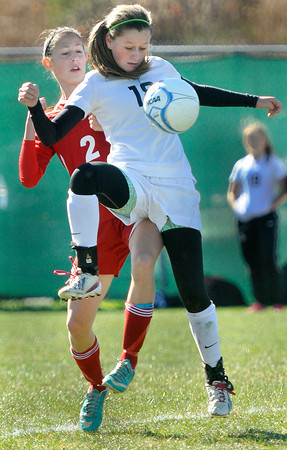 Bridgeport's McKenna Smith, left, defends as Sissonville's Karli Pinkerton controls the ball during the AA/A state Soccer Championship game on Saturday in Beckley. F. Brian Ferguson/The Register-Herald