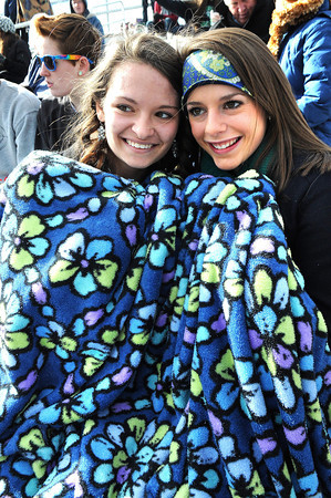 Ellie Castilla, left and Olivia Richardson, of Winfield wrap up in a blanket watching game against Parkersburg in the class AAA boys soccer semi-final match held at the YMCA Youth Sports Complex in Beckley Friday morning.<br /> Rick Barbero/The Register-Herald