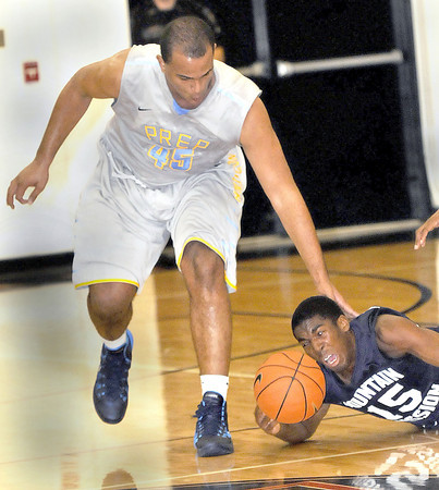 Former Liberty High School basketball star Levi Cook,left, steals the ball away from Mountain Mission's #15 as Cook returned to his former home court on Thursday evening as his Huntington Prep team took on Mountain Mission. F. Brian Ferguson/The Register-Herald