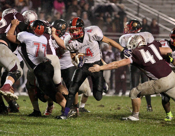 Oak Hill fullback Kadrin Goodman (#4) carries the ball during Red Devils' playoff loss at George Washington Friday night.