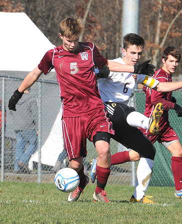 Drew Davis, left, of George Washington, left, and Tyler Steffey, of Jefferson, in the class AAA boys soccer semi-final match held at the YMCA Youth Sports Complex in Beckley Friday morning.<br /> Rick Barbero/The Register-Herald