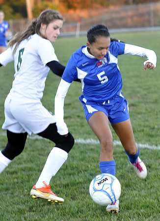 Winfield's Anika Shah, left, battles for the ball against Morgantown's Makayla Schmidt, right during Girls AAA State Tournament action in Beckley. F. Brian Ferguson/The Register-Herald