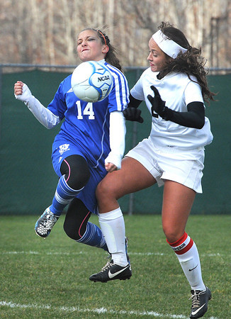 Tressa Bonasso, of Fairmont Senior, left, and Mary Schmeck, of Sissonville in the class AA-A girls soccer semi-final match held at the YMCA Youth Sports Complex in Beckley Friday morning.<br /> Rick Barbero/The Register-Herald