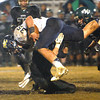 Wil Mayes, of Nicholas Co. gets brought down by a Wyoming Co. defender during game at Wyoming East High School.<br /> Rick Barbero/The Register-Herald