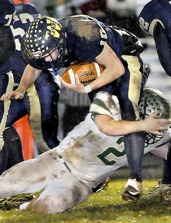 Greenbrier West's Cory Cox picks up extra yards as Notre Dame's Jordan Miller makes the stop during State class A playoff action in Charmco. F. Brian Ferguson/The Register-Herald
