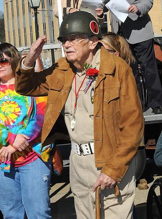 Truman Sayre, WWll Veteran, salutes veterans in the Beckley Veterans Day Parade on Neville Street.<br /> Rick Barbero/The Register-Herald