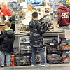 Radio Shack. in the Crossroads Mall. was a hot spot for young Black friday Shoppers.  F. Brian Ferguson/The Register-Herald