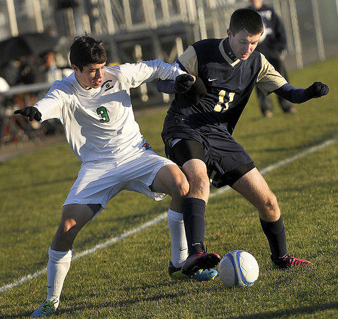 Charleston Catholic's Anthony Cipollone, left, and East Fairmont's Connor Fitz right, fight for the ball during Friday afternoon AA/A Boys State Tournament action in Beckley. F. Brian Ferguson/The Register-Herald