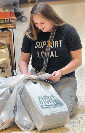 Felicia Puckett literally Shopped Til She Dropped and Checked Her List Twice in the Crossroads Mall. during Black Friday was in Beckley. Puckett was in for the Hollidays from Knoxville, TN for a vist with her family.  F. Brian Ferguson/The Register-Herald