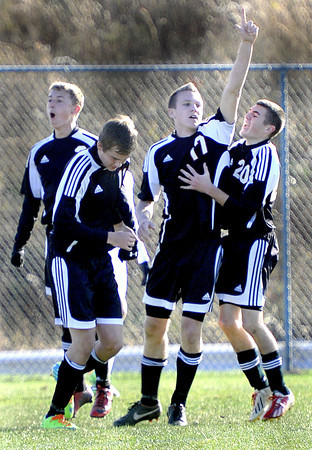 Pikeview's #17 Isaac Van Blaricom celebrates his goal as his fellow players, (from left), Brandon Calfee, Seth Wood, and Alec White join in during the AA/A Boys Stae Soccer Championship game on Saturday in Beckley. F. Brian Ferguson/The Register-Herald