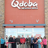 Monday marked the official opening of Qdoba Mexican Grill in the Galleria, (from lefta), Tammy Harris, Denise Southern, Gary Hartley, Ellen Taylor, Victor Flanagan, Jason Mink, Mayor Emmett Pugh, Terry Mayhew, Jennifer Suderman, and Paula Shrewsberry. F. Brian Ferguson/The Register-Herald