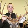 Josh Lambert, police officer Division Natural Resources, holds a 12 point trophy buck he confiscated in Mcdowell County.<br /> Rick Barbero/The Register-Herald