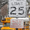 Early morning snow caused Tuesday commuters to take it slow along Main Street in Oak Hill as winter weather gave an early preview of the season ahead. F. Brian Ferguson/The Register-Herald