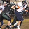 Casey Saunders, left, and John Morgan of Wyoming East, tackles, Tyler Sagraves, of Nicholas Co. during game at Wyoming East High School.<br /> Rick Barbero/The Register-Herald