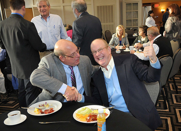 A.J. Sparacino, left, shakes Charlie Houck's hand during the Spirit of Beckley Kick-Off Breakfast held Tuesday morning in the ball room at Black Knight Country Club.<br /> Rick Barbero/The Register-Herald