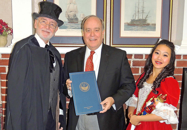 "Jerry Rose, director of the Beckley Dance Theatre, stands with Mayor Emmett Pugh and 15 year-old Elizabeth Koh, who will be filling the shoes of Clara for the 36th season of ""The Nutcracker.""<br /> Brandi Underwood/The Register-Herald"