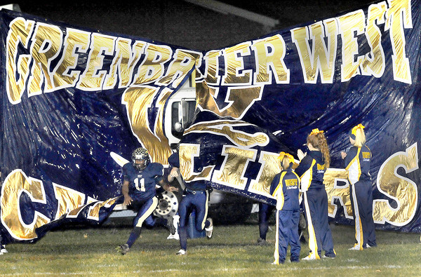 Malik Boatwright leads his Greenbrier West Team onto the field to kick off State class A playoff action in Charmco. F. Brian Ferguson/The Register-Herald
