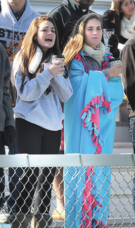 Maggie Helmick, left, and Abbi Helmick, students at George Washington, brave the cold in match against Jefferson in the class AAA boys soccer semi-final match held at the YMCA Youth Sports Complex in Beckley Friday morning.<br /> Rick Barbero/The Register-Herald