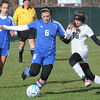 Maddie Stevenski, 6, of Fairmont Senior and Karli Pinkerton, 18, of Sissonville, go after the ball in the class AA-A girls soccer semi-final match held at the YMCA Youth Sports Complex in Beckley Friday morning. Girl in Background, Ivey Nucilli, 1, of Fairmont<br /> Rick Barbero/The Register-Herald