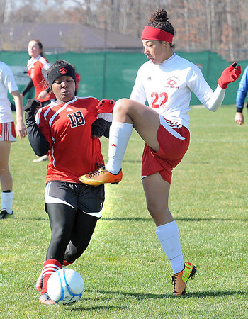 Crysta Meekins, left, of Pikeview and Celena Bryant, of Bridgeport in the class AA-A girls soccer semi-final match held at the YMCA Youth Sports Complex in Beckley Friday morning.<br /> Rick Barbero/The Register-Herald