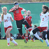 Alexis O'Dell, of Pikeview, center, tries to kick the ball away from, Whitney Bryant, left, and Tori Coulter, of Bridgeport in the class AA-A girls soccer semi-final match held at the YMCA Youth Sports Complex in Beckley Friday morning.<br /> Rick Barbero/The Register-Herald