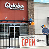Qdoba Mexican Grill in the Galleria, Director of Operations,  Jason Mink, install the Grand Opening sign shortly before the Monday opening. F. Brian Ferguson/The Register-Herald