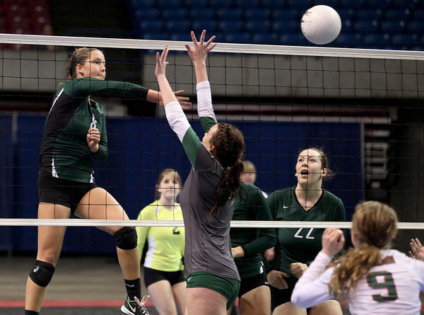 Greenbrier East's Ellen Henthorn (#8) spikes the ball as Musselman's Megan Raney (#10) tries to block it during the Class AAA championship match Saturday morning in Charleston. (Photo by Brad Davis)