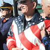 Bill Brown, of Beckley, Vietnam Veteran watches the Beckley Veterans Day Parade on Neville Street.<br /> Rick Barbero/The Register-Herald