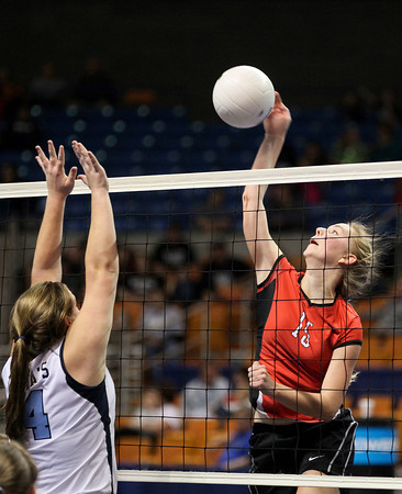Greater Beckley Christian's Janalee Lehman (#15) attempts to spike the ball as Pendleton County's Hillary Ord (#44) tries to block it during the Crusader's Class A State Volleyball Tournament opening round victory over the Wildcats Friday evening.