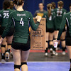 Greenbrier East's Lindsey Level (#4) carries the Lady Spartans' team plaque to the bench as they swap sides between sets during the Class AAA Championship match against Musselman Saturday morning in Charleston.